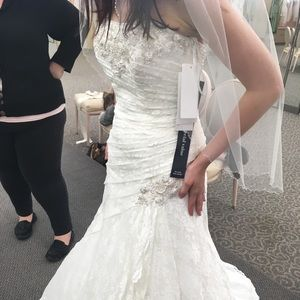 Size 4 wedding dress, slip, and garment bag.